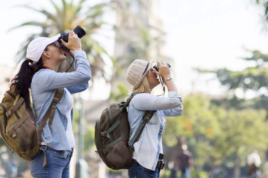 Shallow depth of field photo of tourists taking photographs.
