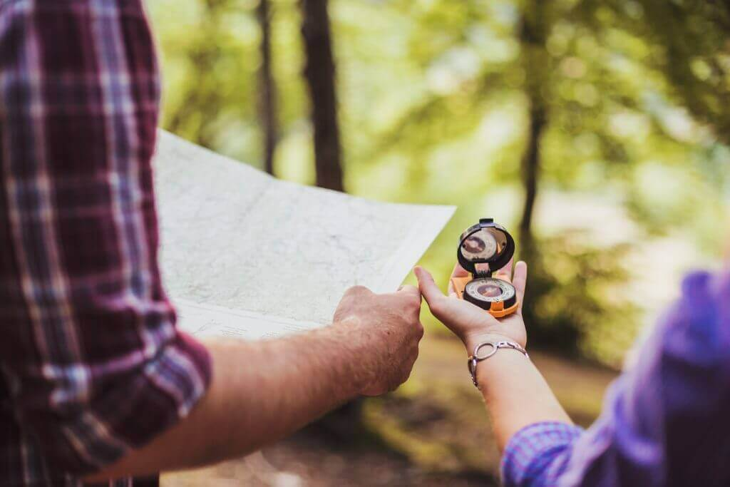 Happy couple going on a hike together in a forest. Shallow depth of field